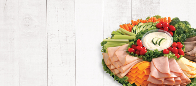 Party tray with turkey, ham, cheese, and vegetables