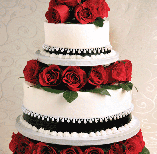 Elegant Tiered cake w/ Red Roses & black ribbon