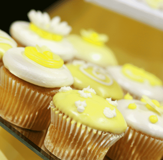 Yellow & white cupcakes w/ floral design